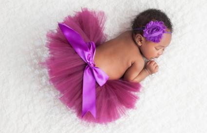Newborn Baby Girl Wearing a Purple Tutu