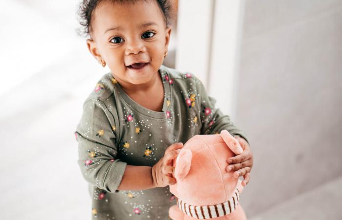 Smiling toddler with toy