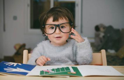 baby girl wearing oversized glasses