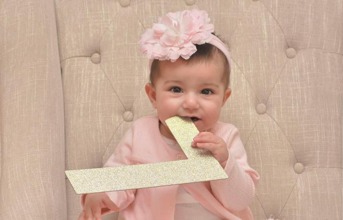 Cute Baby Girl Biting Letter L