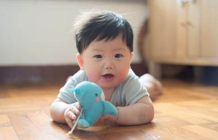 Baby boy playing toy whale
