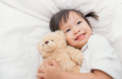 cute girl hugging teddy bear