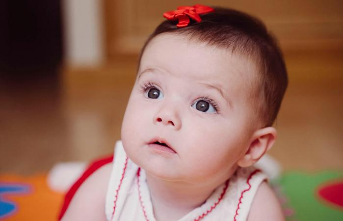 cute baby girl with red hair clip