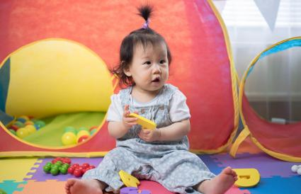 baby girl playing alphabet blocks