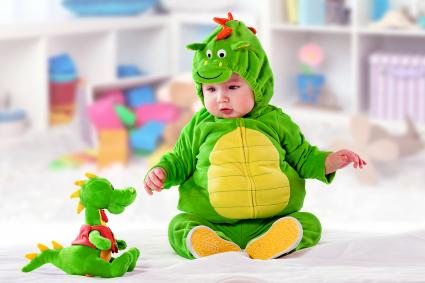 Baby boy in a green suit of a dragon