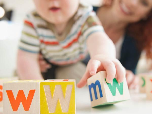 Baby boy spelling WWW with blocks