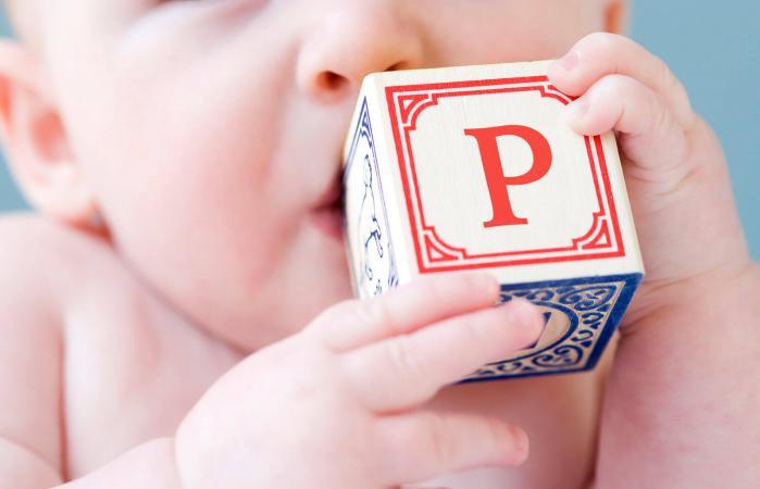 baby biting on alphabet block
