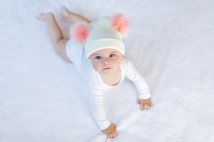 Baby girl with warm white and pink hat