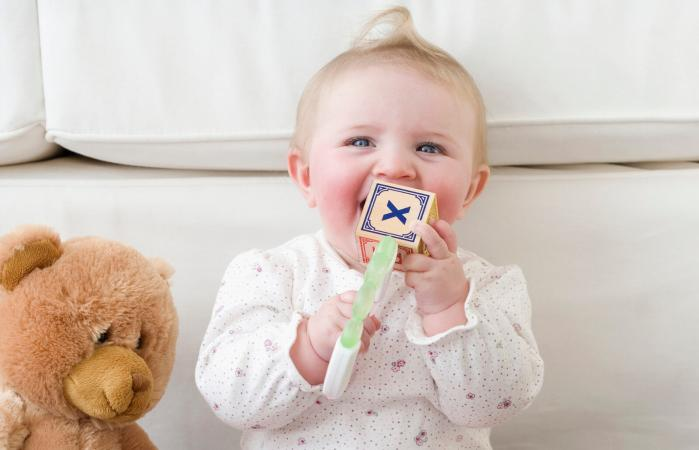 Baby playing with alphabet blocks