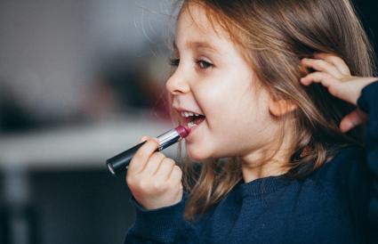 Little girl's first lipstick