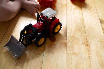 Toy tractor and baby
