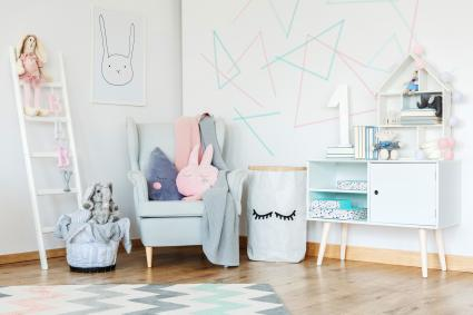 Elegant kid room interior decorated in Scandinavian style with modern furniture and geometric figures