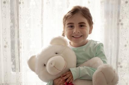 Cute girl loving her teddy bear