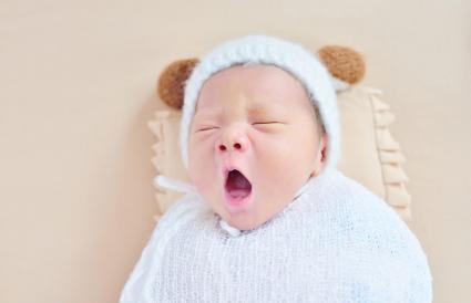 newborn at beige sheets