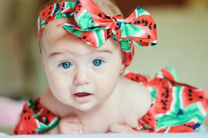 Portrait of dressed baby girl with hair-band