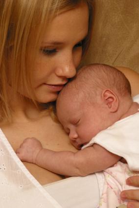 mom holding sleeping infant
