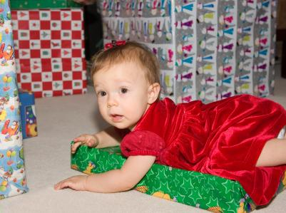Baby in a red velvet Christmas dress