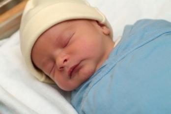 newborn baby with cap