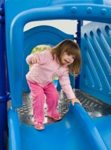 Child on playground slide