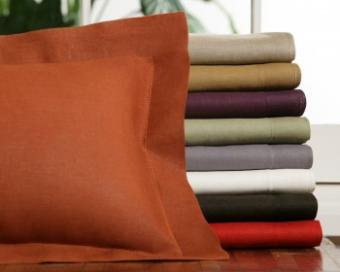 Linen pillow and stack of pillowcases