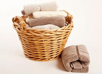 fluffy folded towels in basket