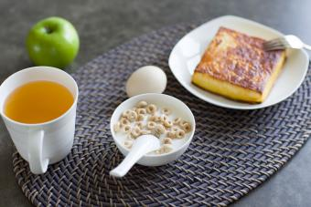 Breakfast on woven oval placemat