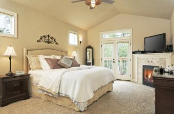Beige master bedroom with fireplace