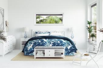 tropical print bedspread in white bedroom