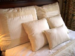 Typical style of boutique hotel bedding
