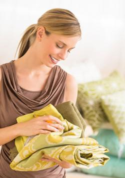 Woman examining sheets in bedding store
