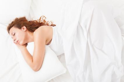 Woman sleeping with body pillow