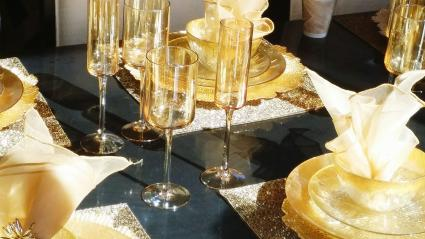 Wine glasses and gold square placemats