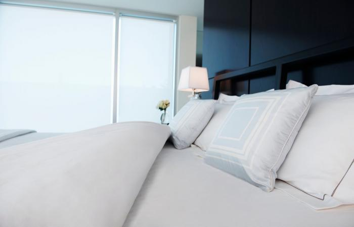 Plush White Pillows On White Bed