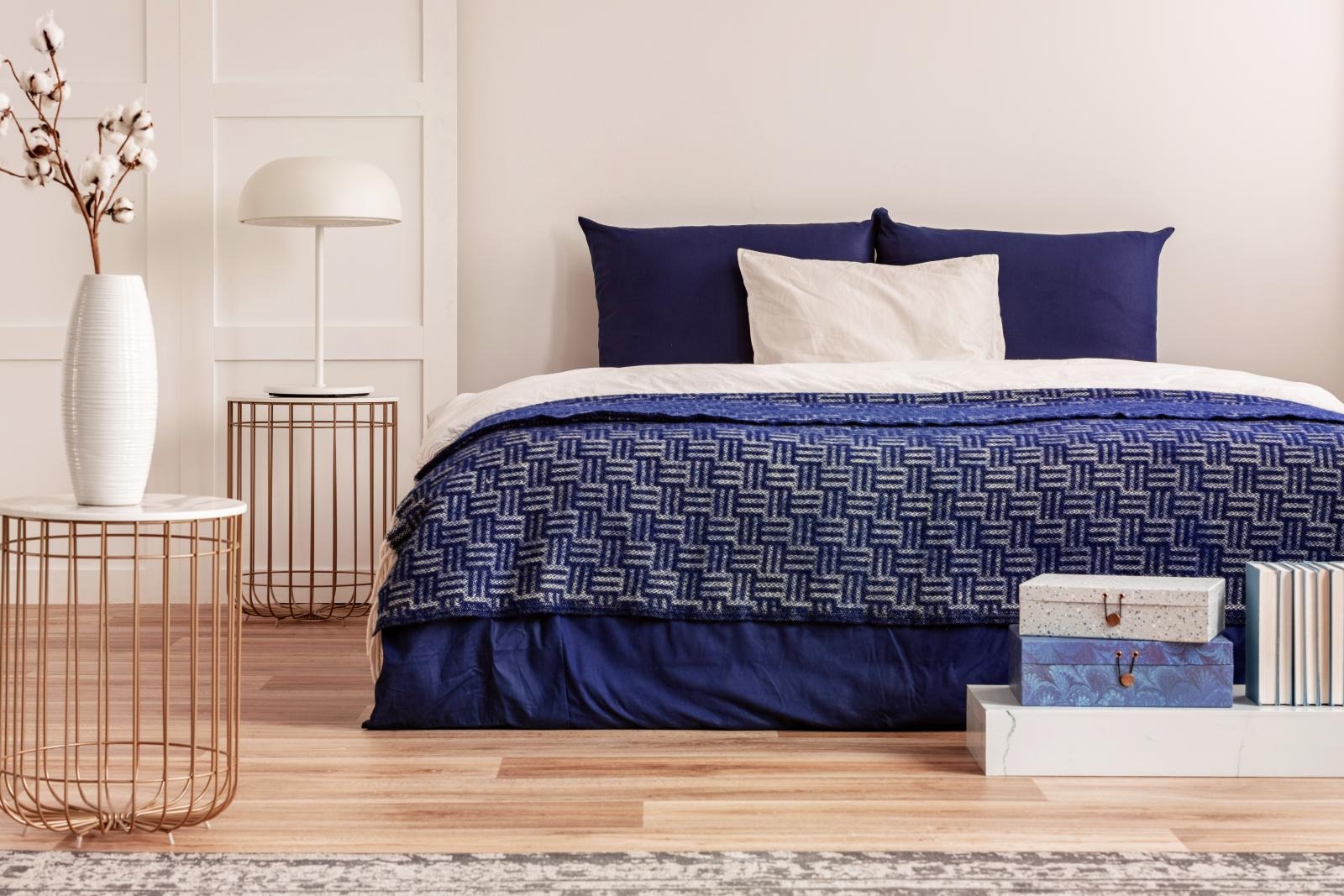 King size bed with navy blue bedding