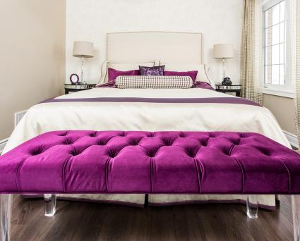 Purple decorated guest bedroom