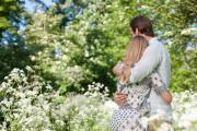 Couple hugging in field of flowers