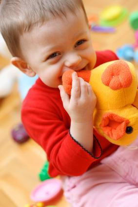 Boy holding toy duck