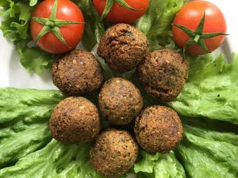 Falafels with Cherry Tomatoes and Lettuce on Plate