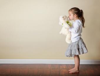 girl kissing stuffed animal