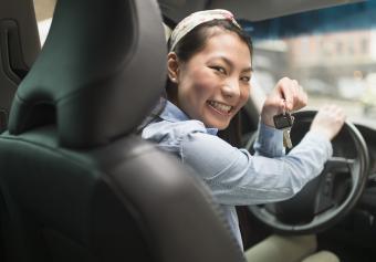 teenage girl holding keys to car