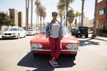 https://cf.ltkcdn.net/best/images/slide/229810-704x470-woman-standing-in-front-of-car.jpg