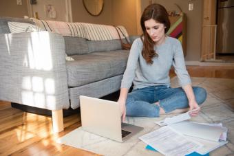 https://cf.ltkcdn.net/best/images/slide/229815-704x470-checking-finances-on-computer.jpg