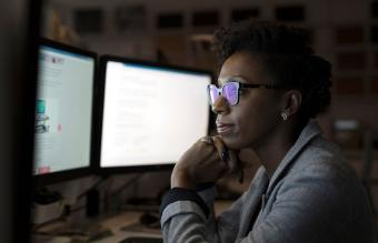 Businesswoman working late at computers