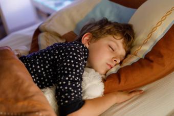 boy sound asleep in bed
