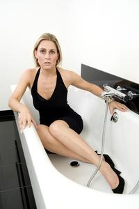 Blonde woman in tub