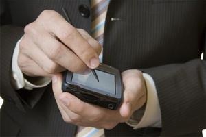 Businessman using a PDA - photo by Piotr Bizior