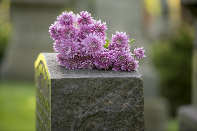 Purple flowers on a headstone