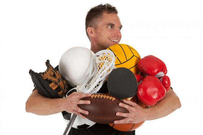 Man holding sports equipments