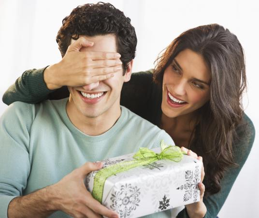 woman giving boyfriend a gift