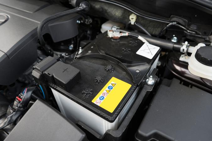 Battery under hood of car